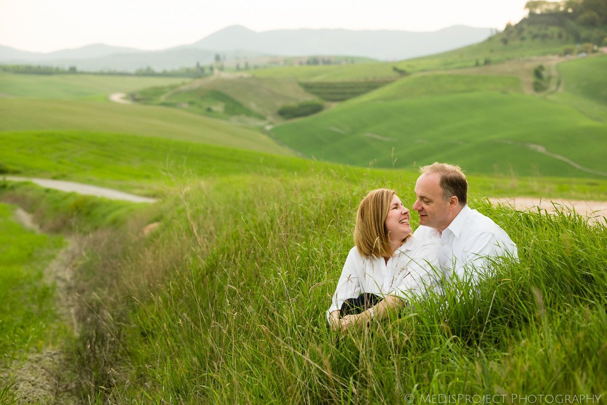 mid-age couple sitting in the fields