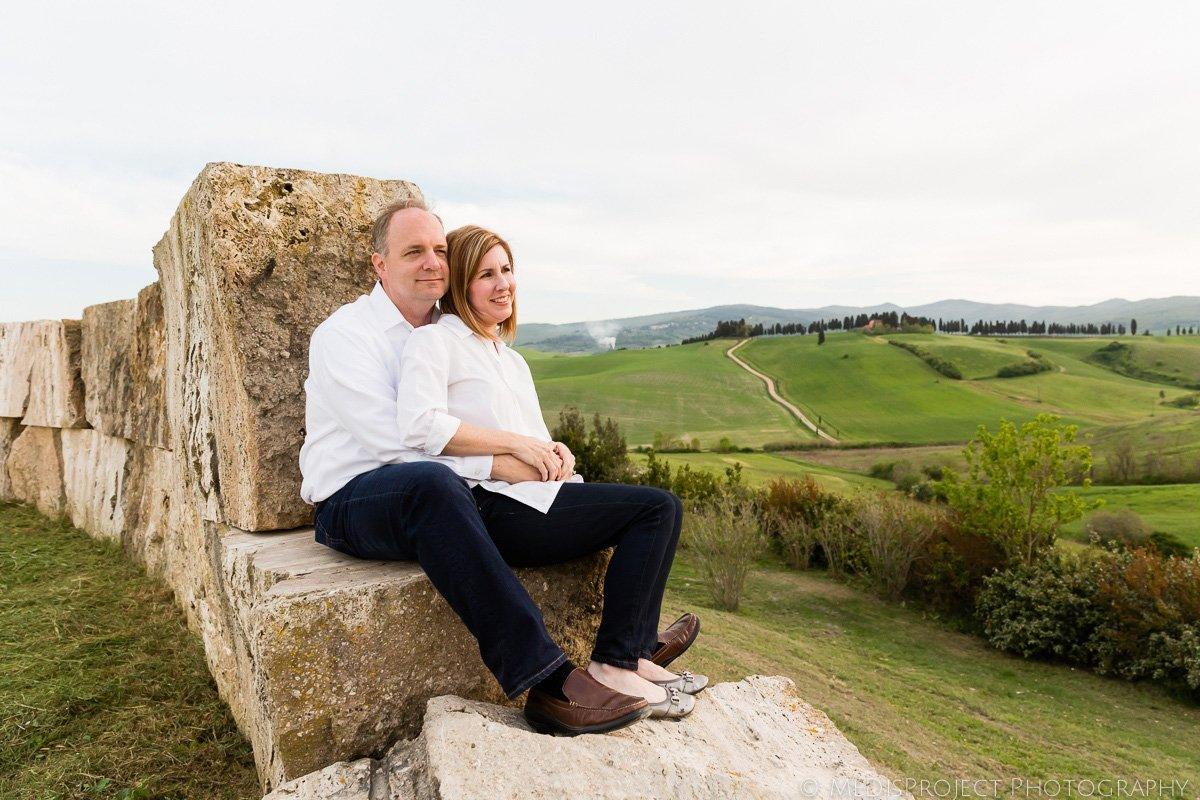 mid-age couple sitting on the rock