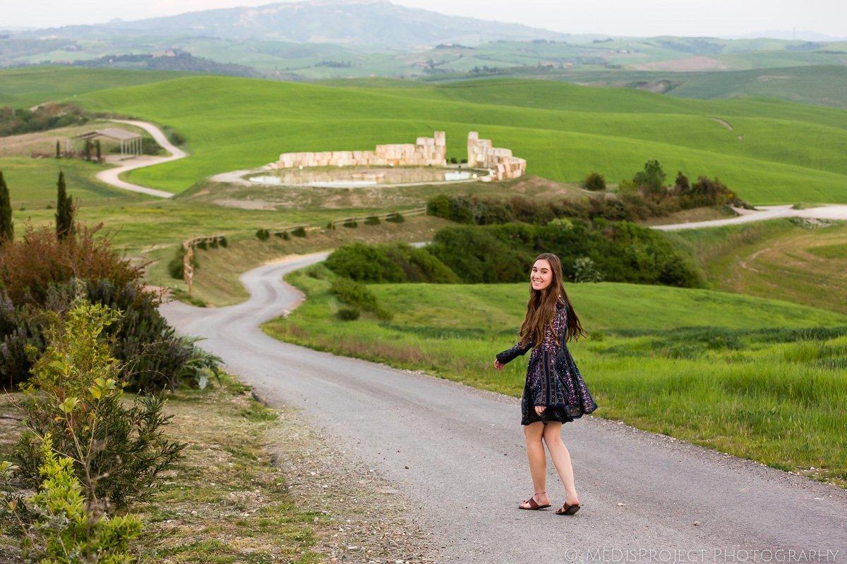young girl walking in Teatro del Silenzio