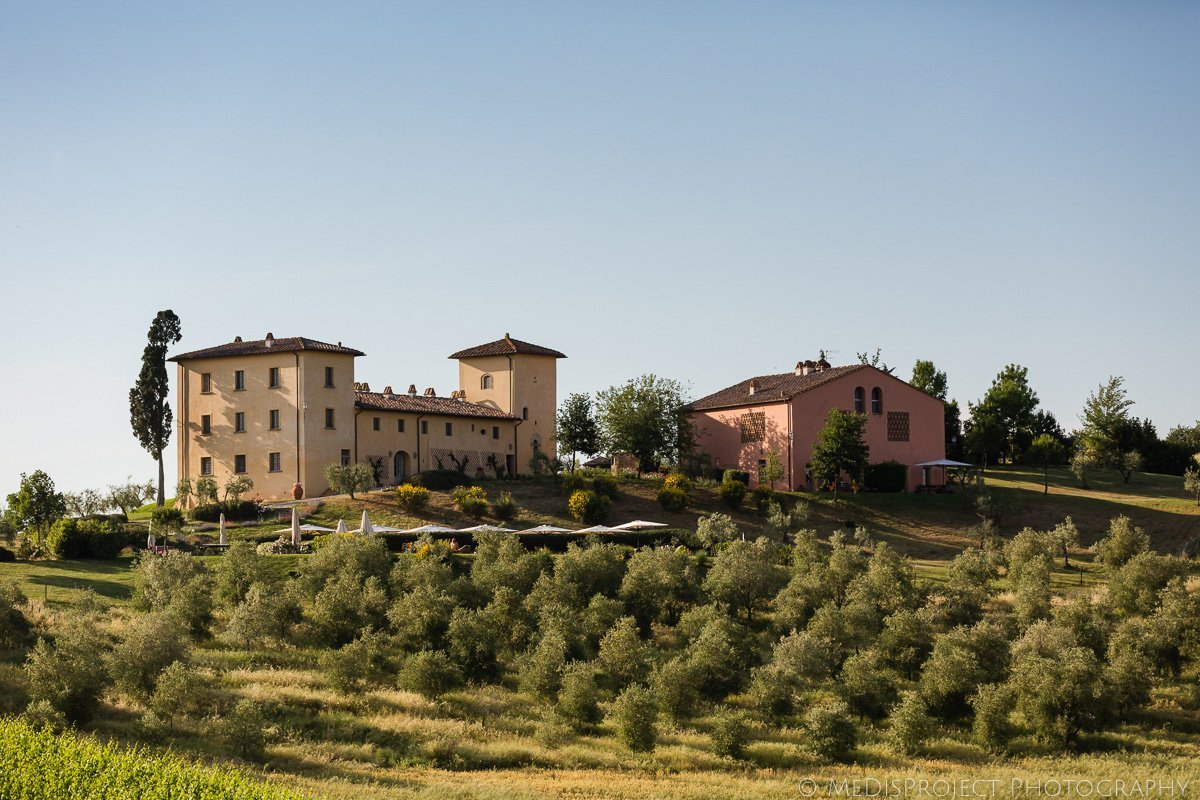 Typical Tuscan villa surrounded by olive grows