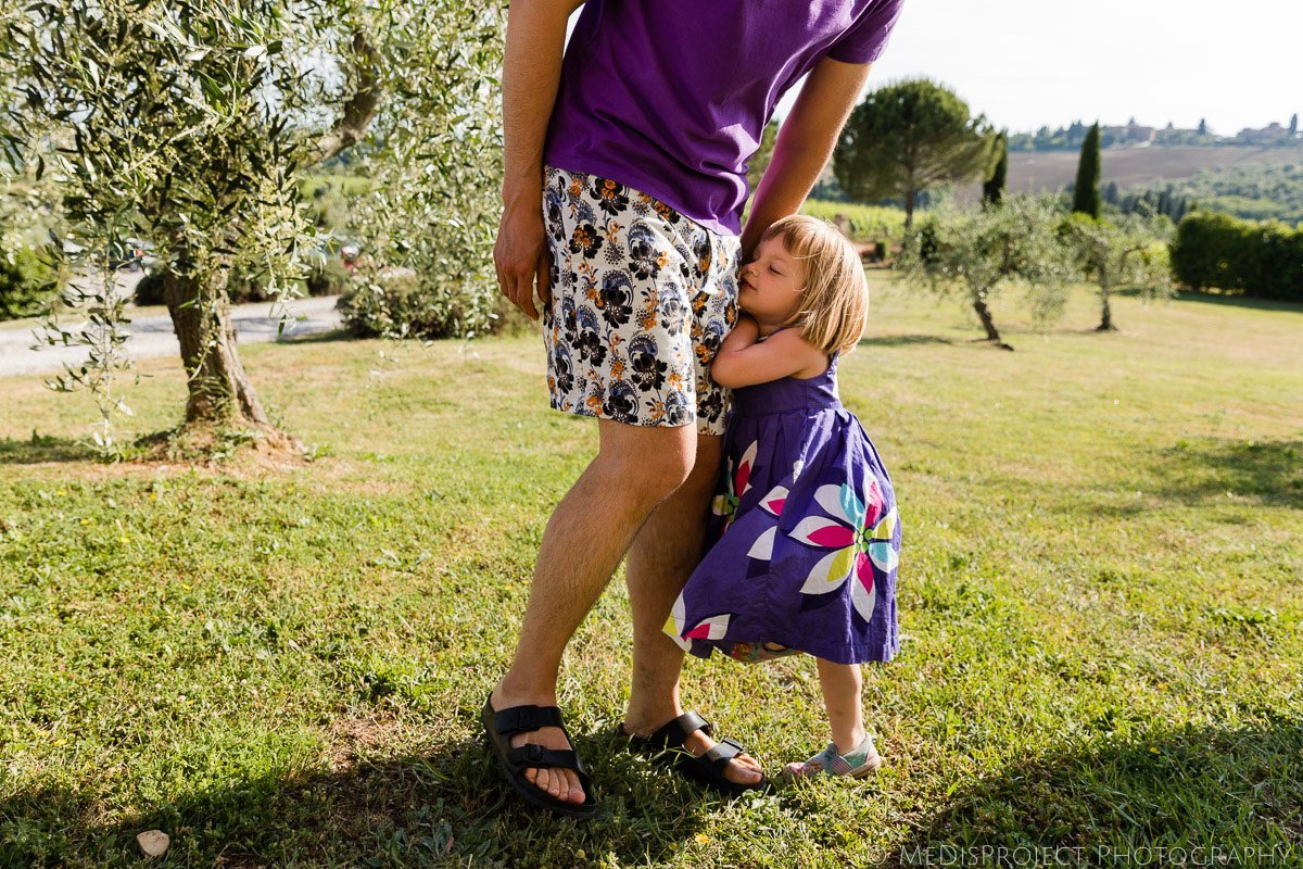 little daughter hugs daddy's leg