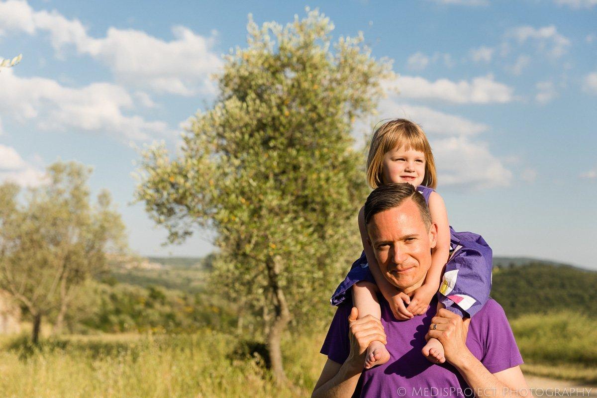 girl on dads shoulder