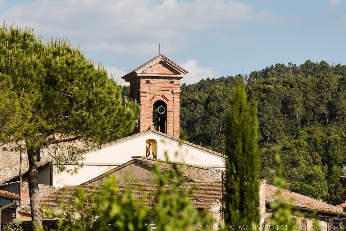 Tuscan village church's bell gingles after a wedding