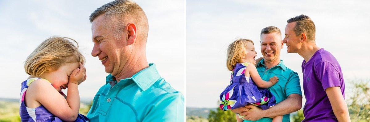 little girl kisses her daddy