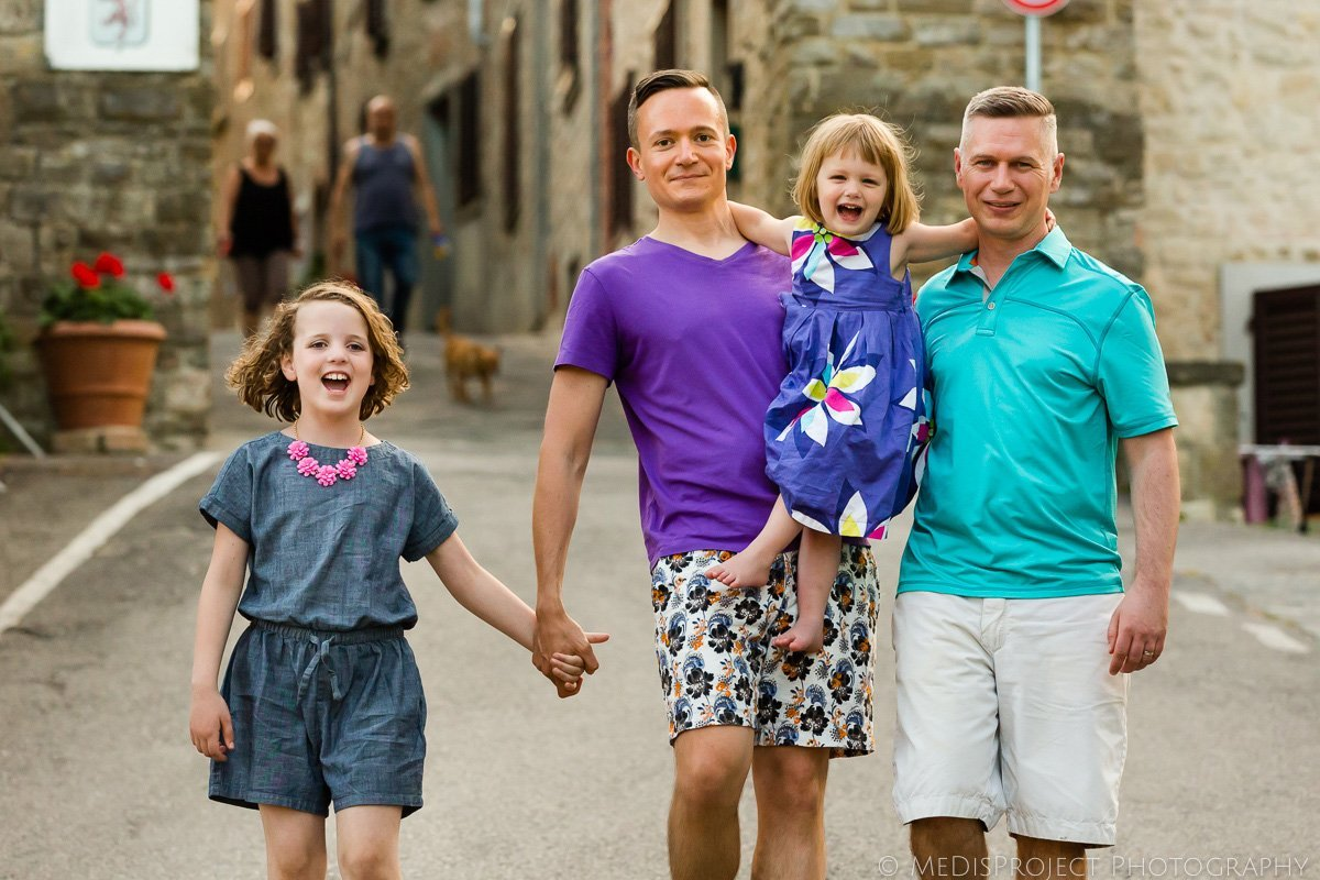 gay family with two daughters having a walk