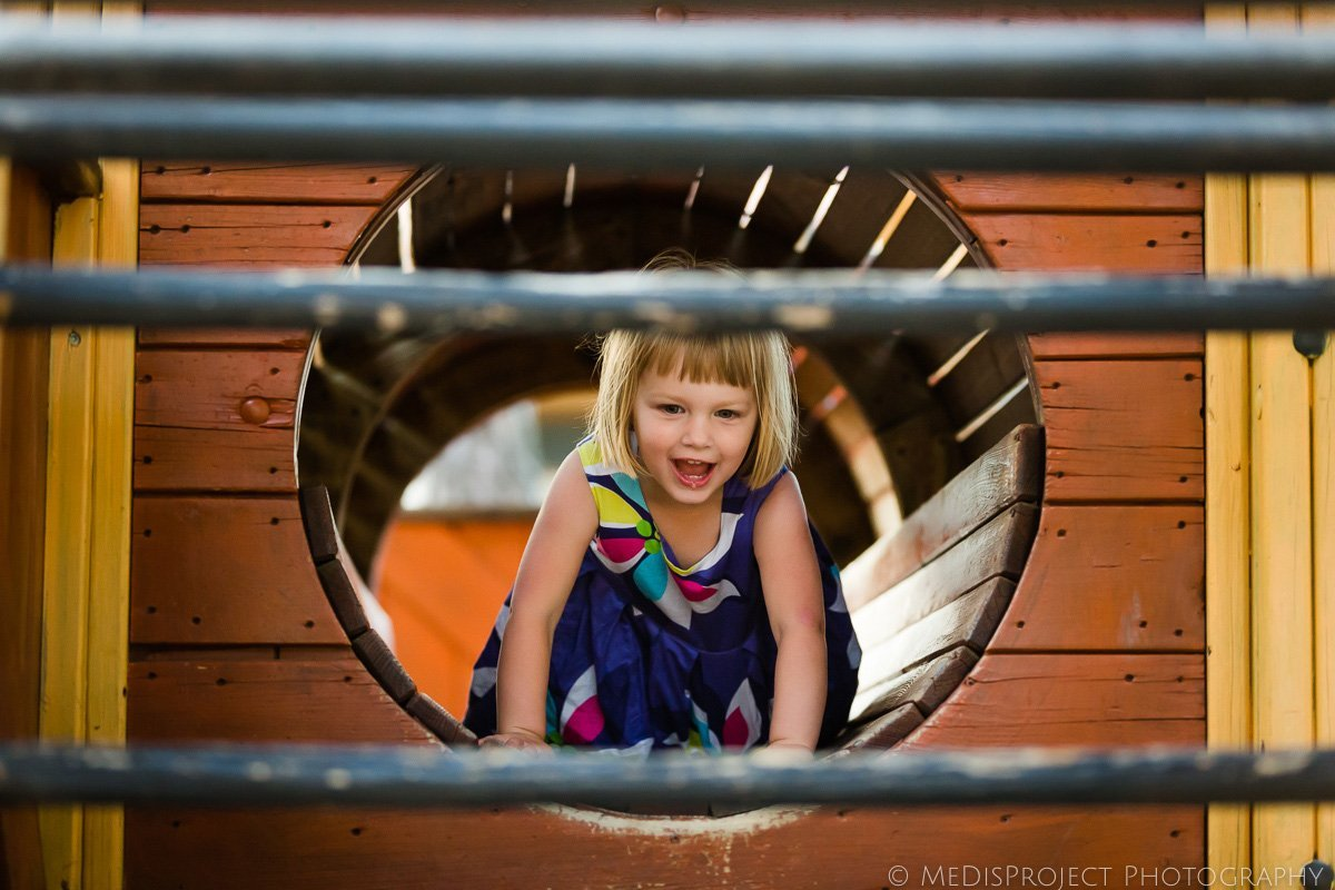 little girl playing at the playground in Italy