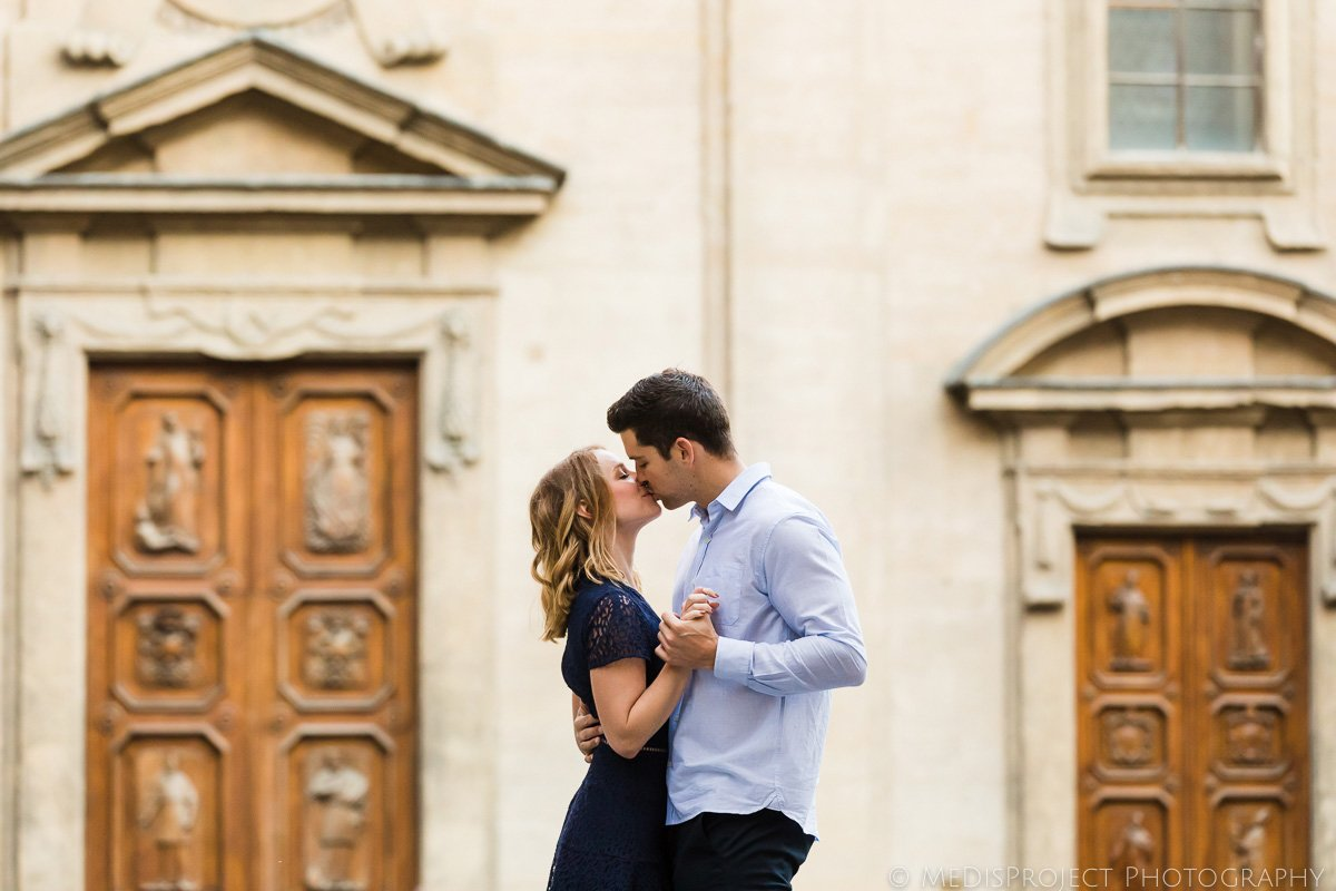 a couple dancing and kissing
