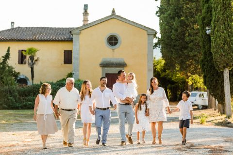 big family walking down the road with the church on the background