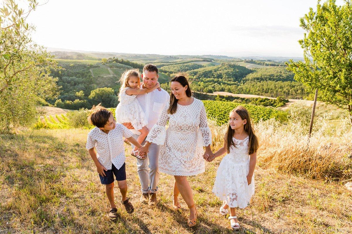 family of 5 walking in the fields