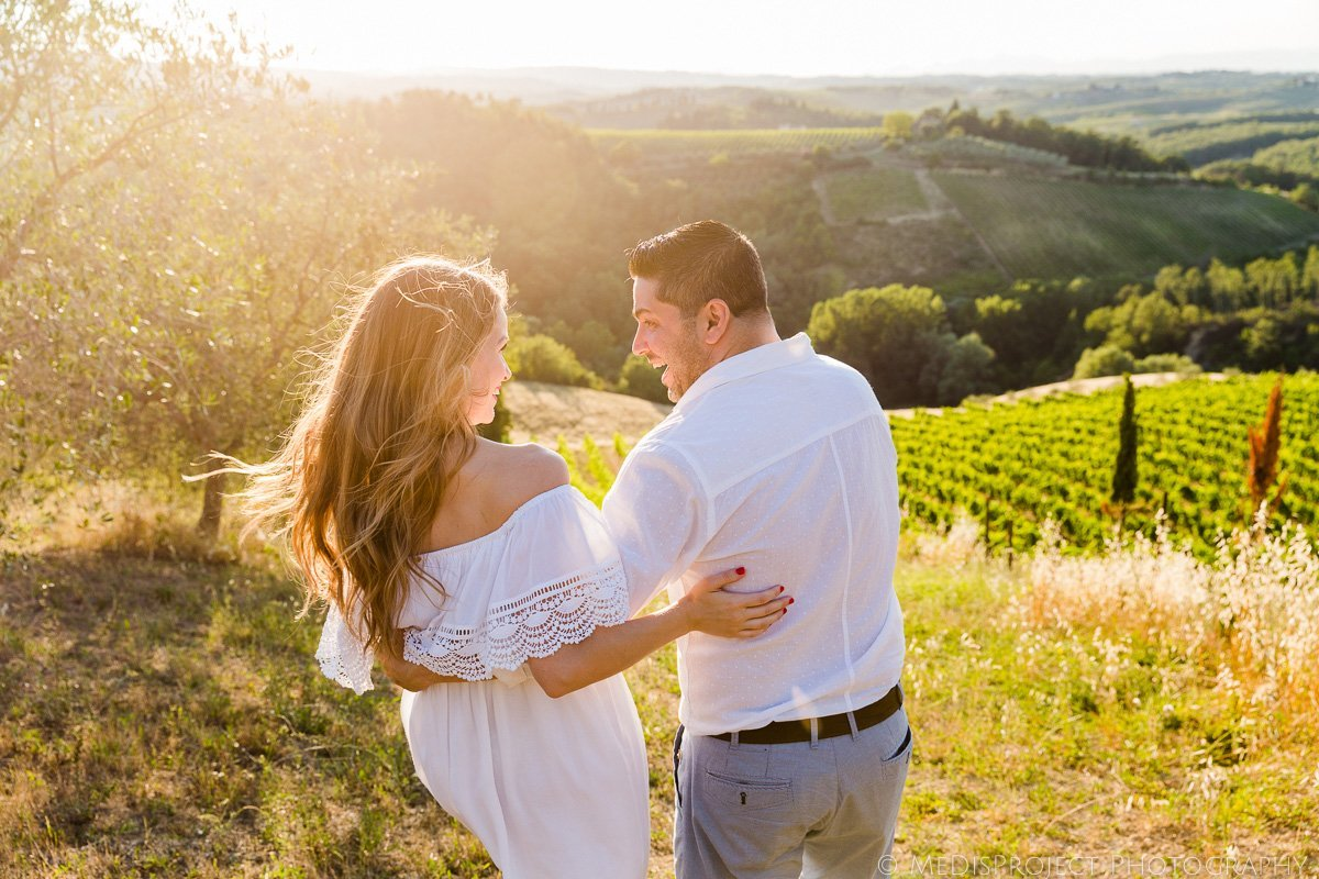 a couple walking in the vineyards