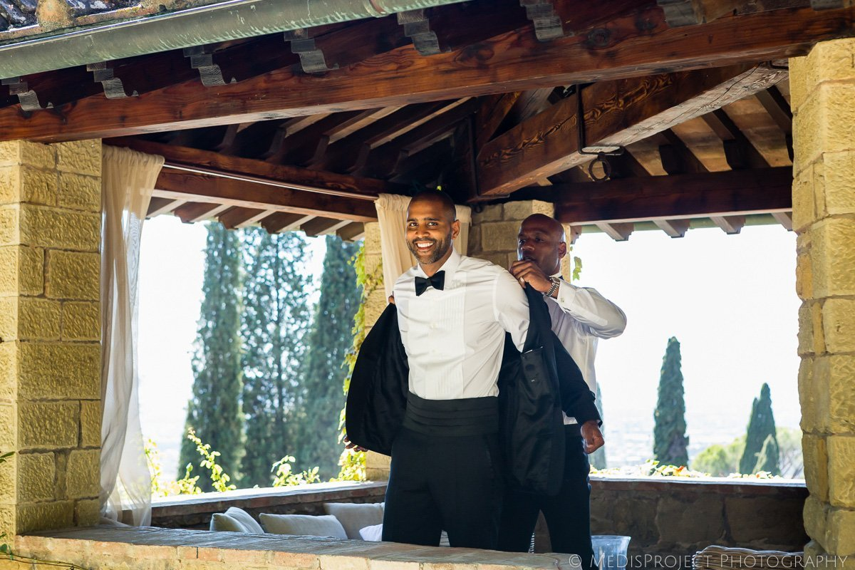 beautiful black groom getting ready at Villa le Fontanelle