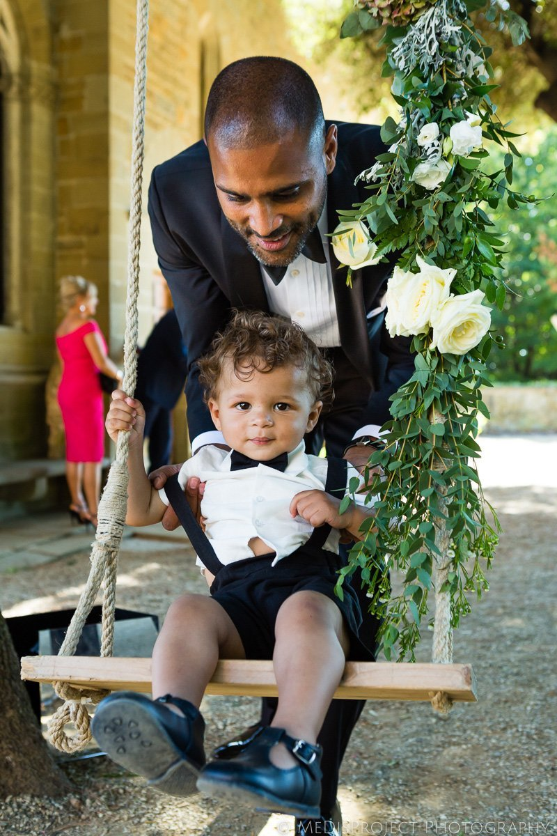 the groom with his son before the ceremony