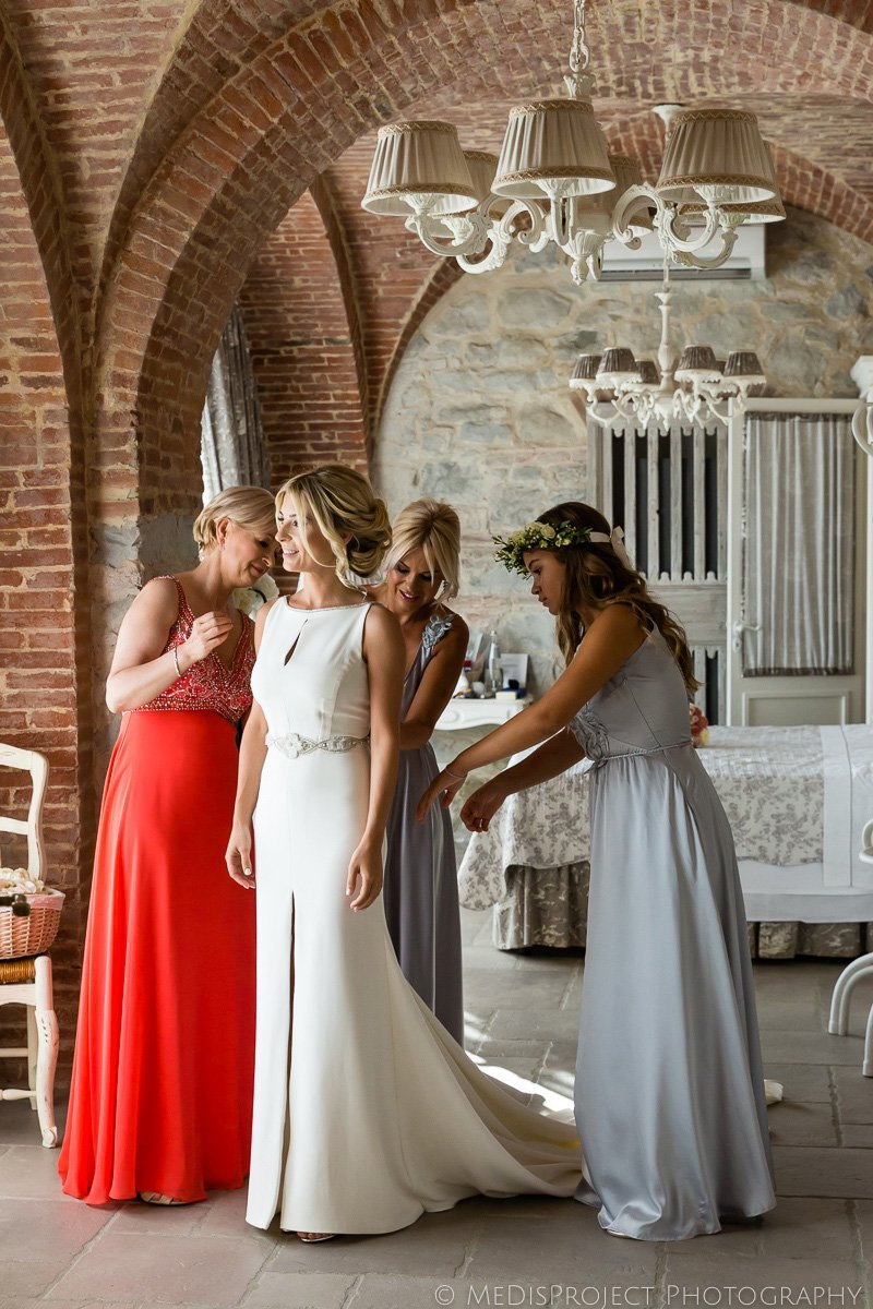 bride getting dressed at Villa le Fontanelle