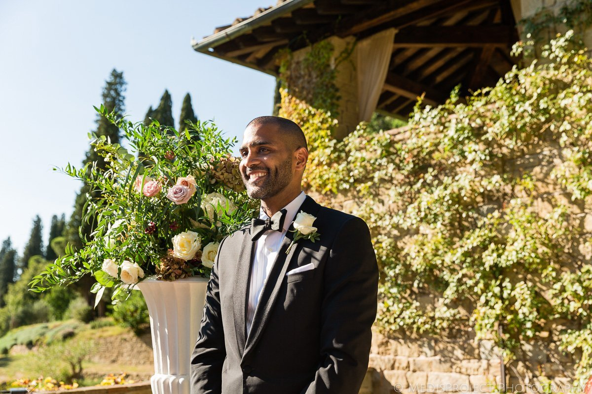 handsome african American groom waiting for the bride