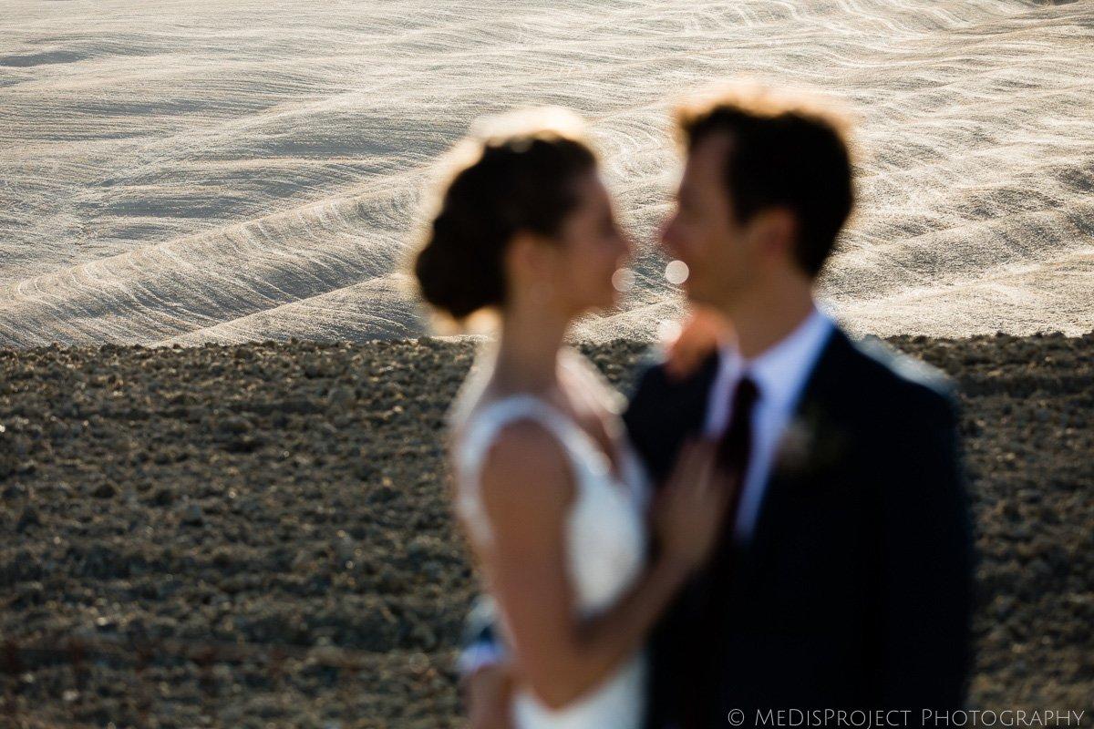 bride and groom portrait with crete senesi