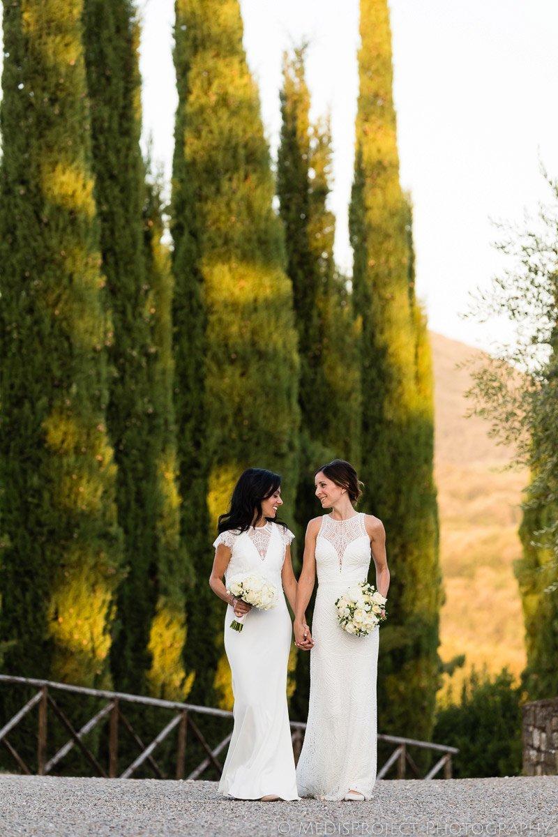 brides walking in Borgo San Felice, Tuscany