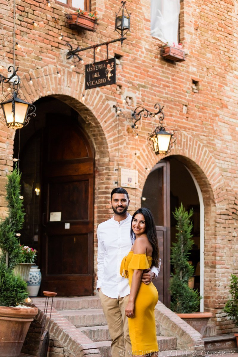 Just engaged couple having a romantic dinner at the Osteria del Vicario in Certaldo