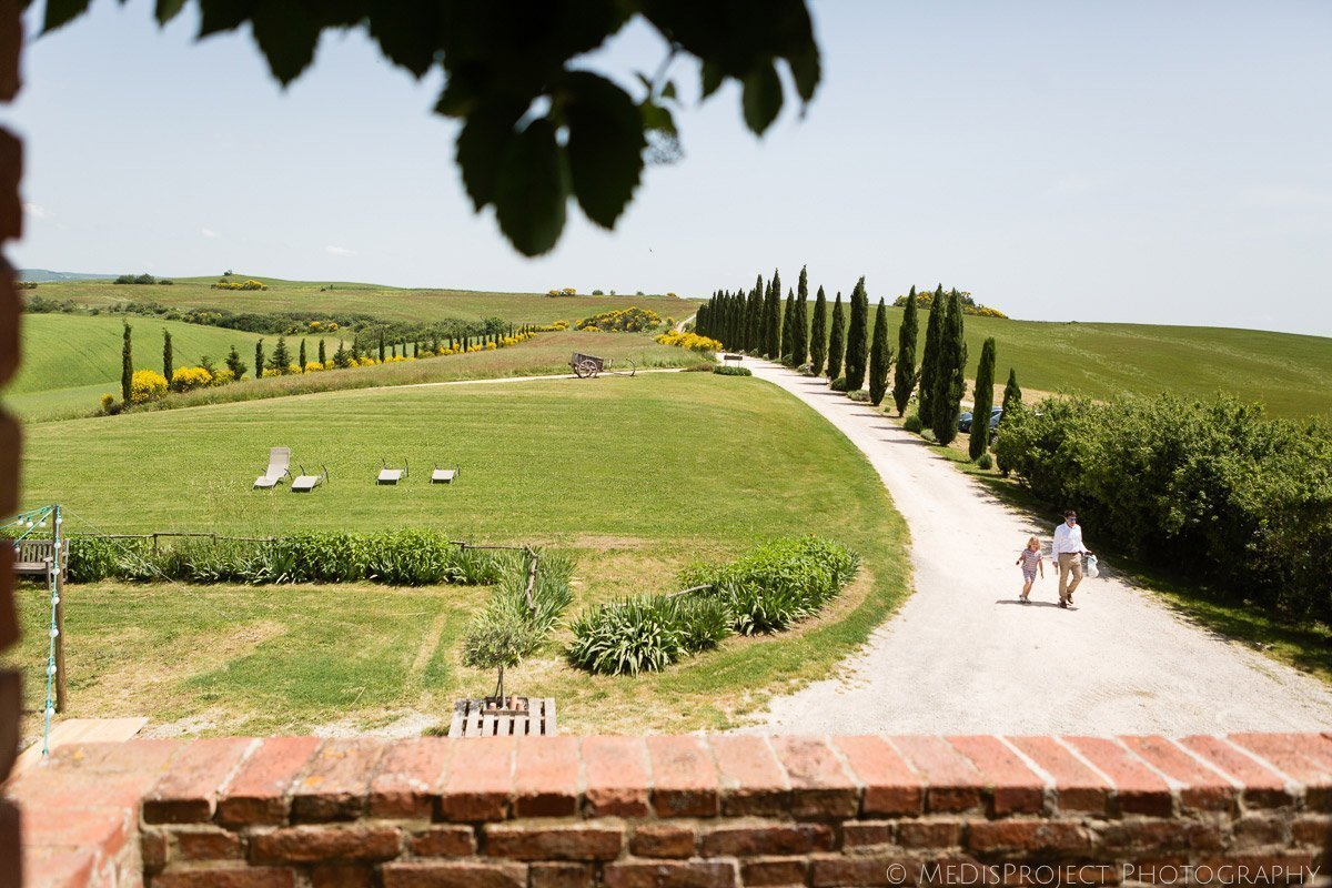 A typical Valdorcia Tuscan landscape with cypresses and rolling hills