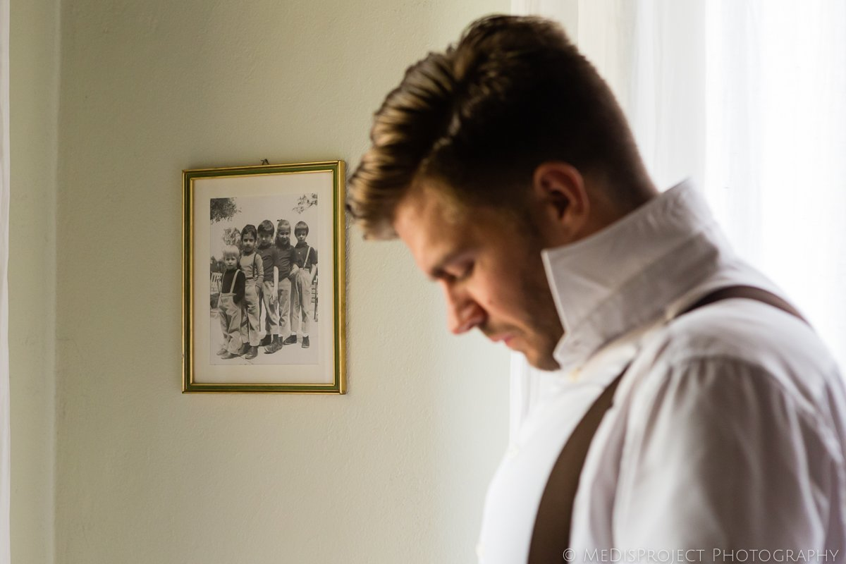 detail of the groom getting ready
