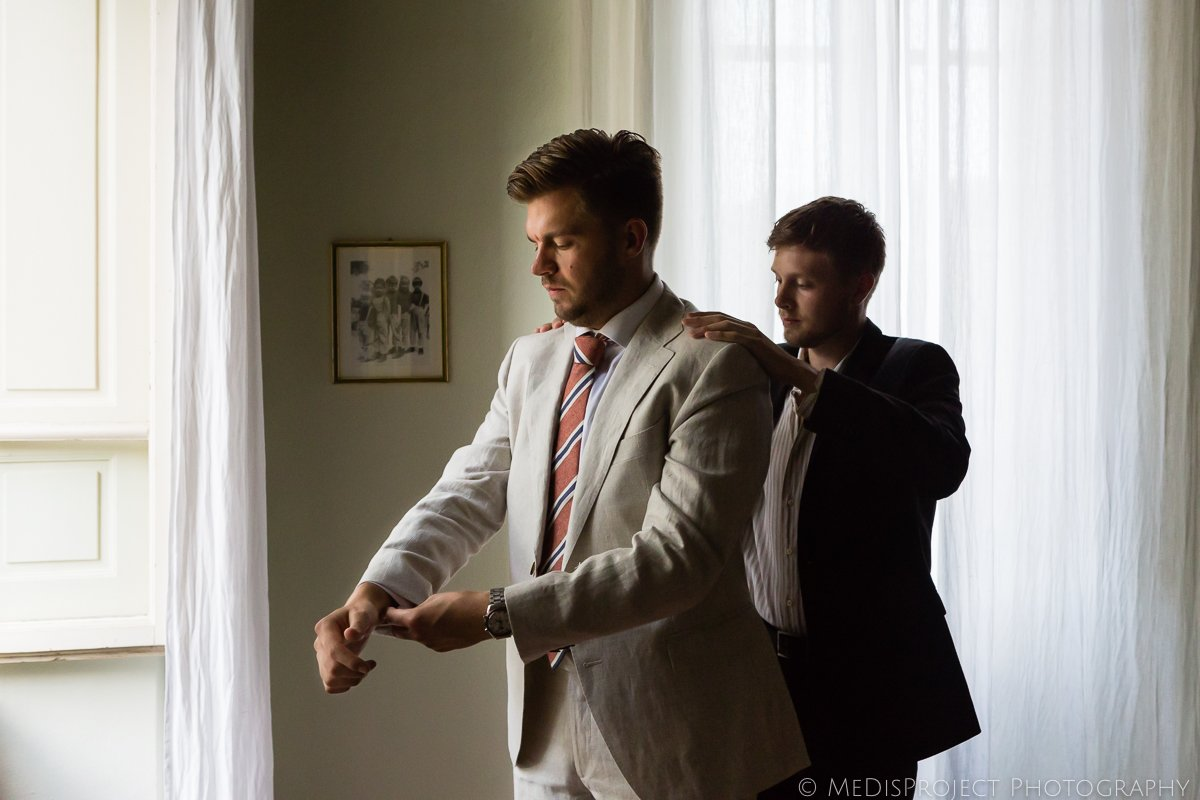 the groom getting ready with a groomsman