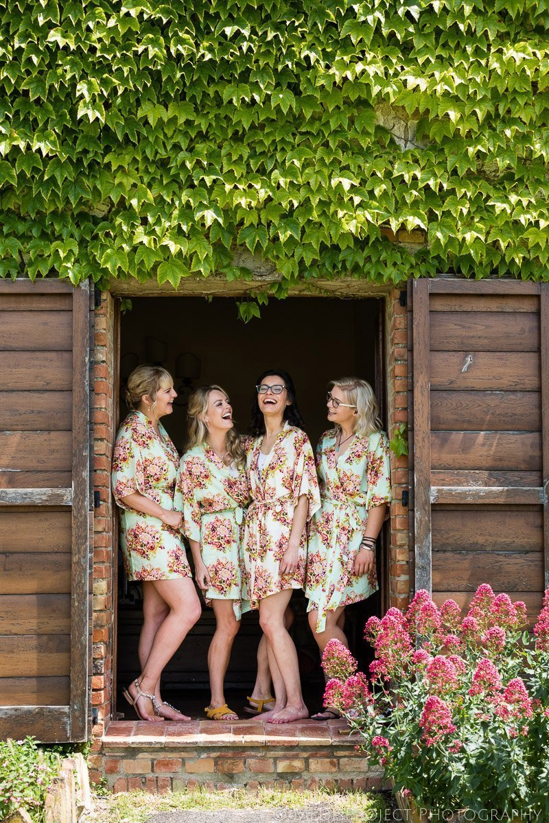 the bride and her bridesmaids wearing nightgowns