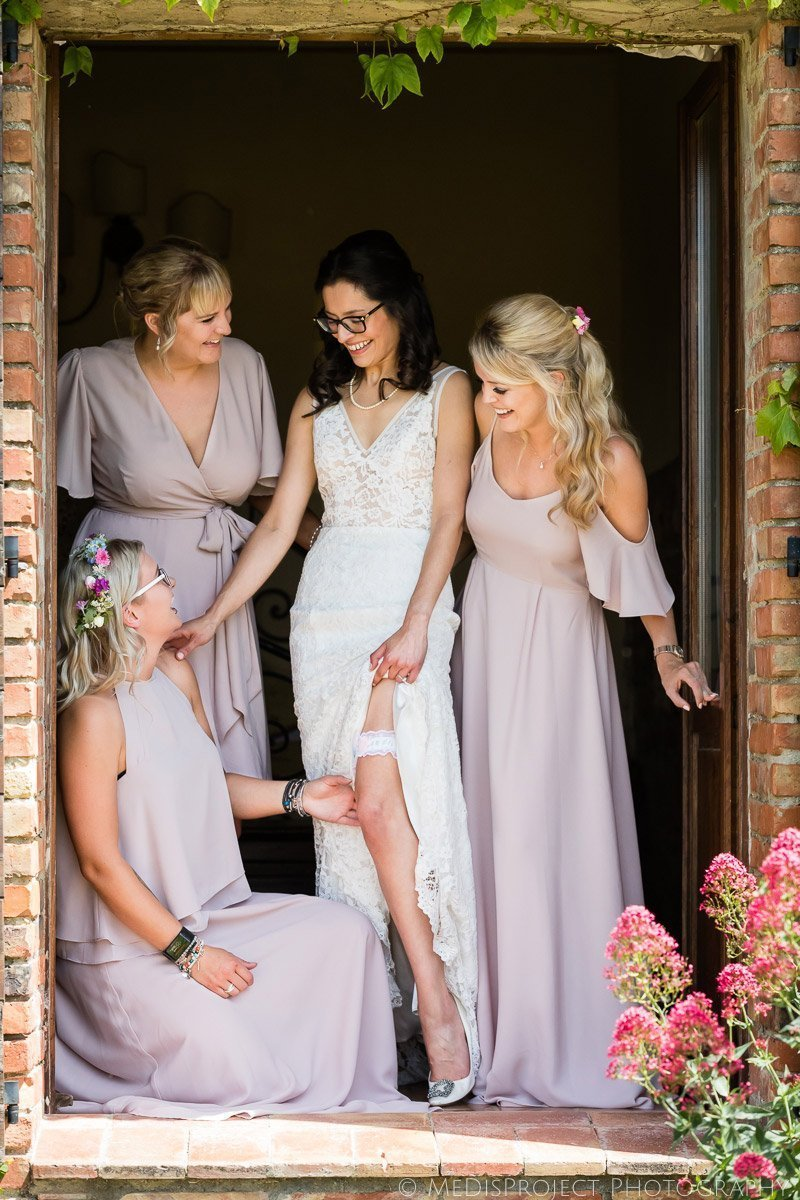 the bride and her bridesmaids in their wedding dresses