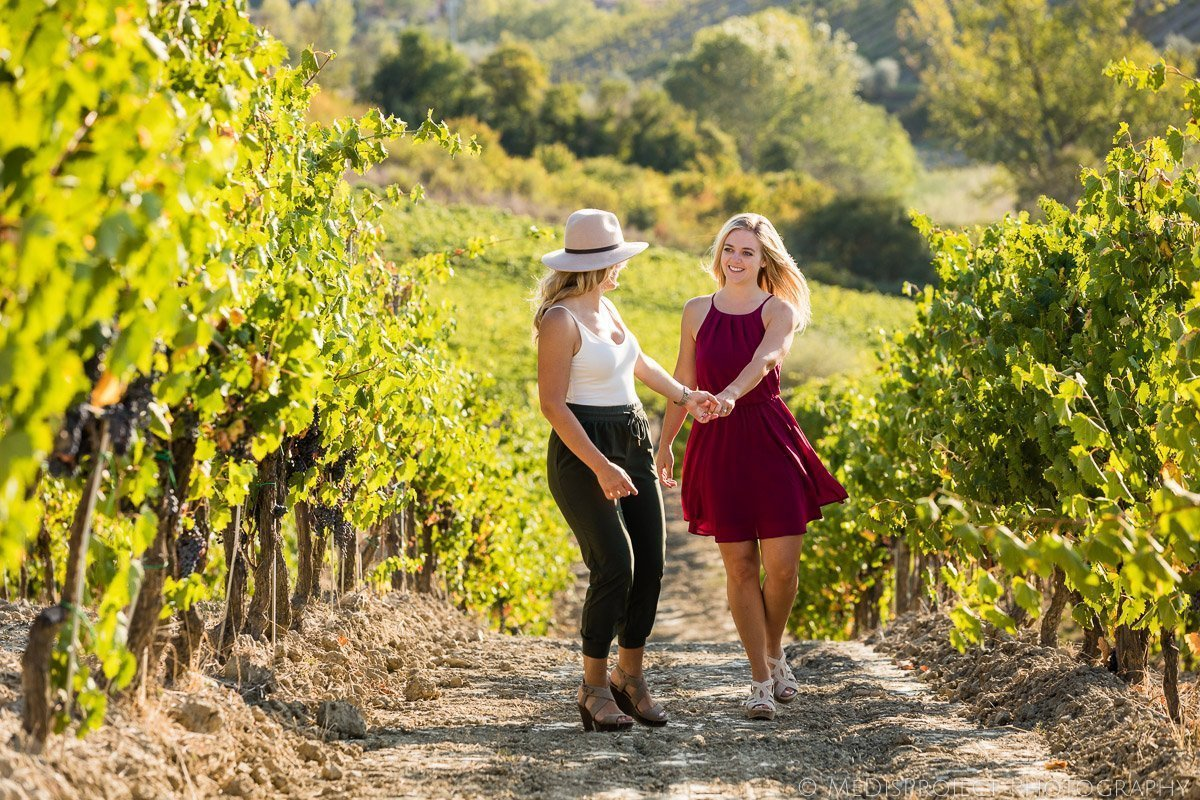 Lesbian couple photographers in Tuscan countryside