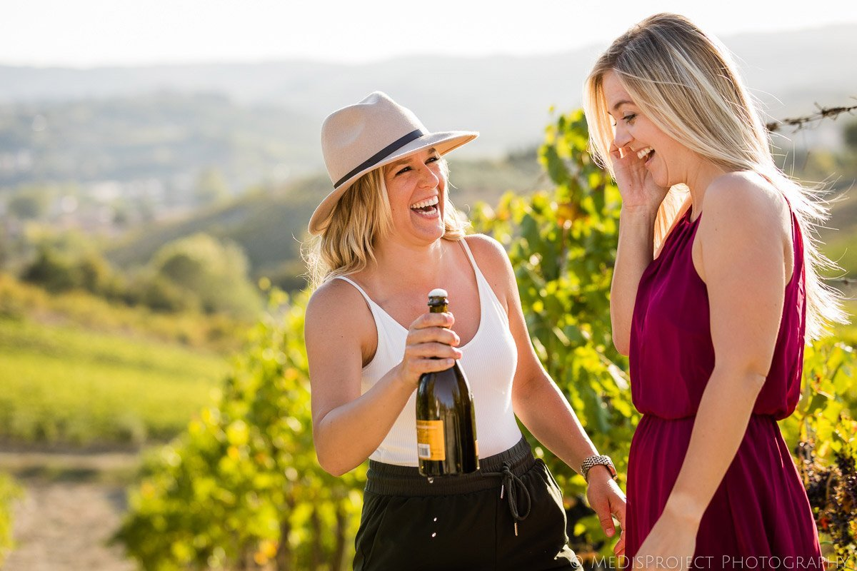 Lesbian couple celebrating their engagement with Prosecco toast