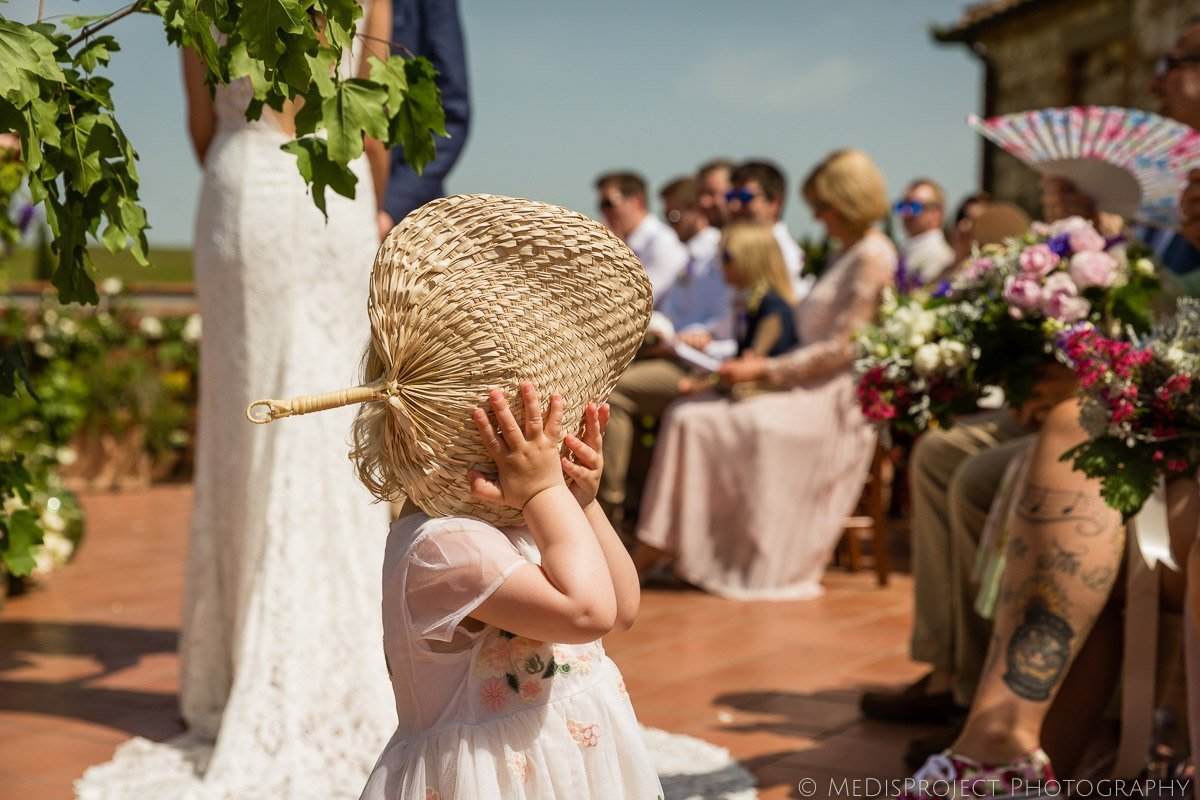 candid moment during a wedding ceremony at Il Rigo