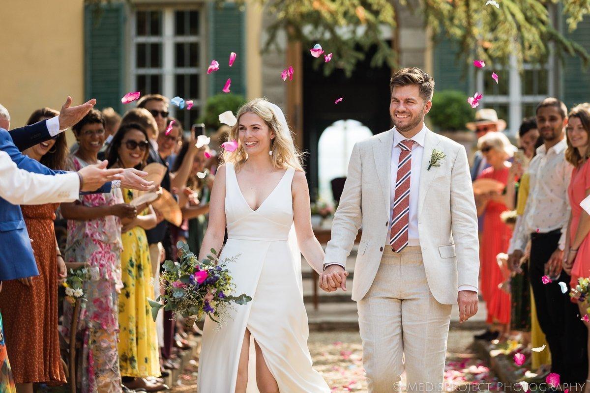 The happy couple exits the wedding ceremony