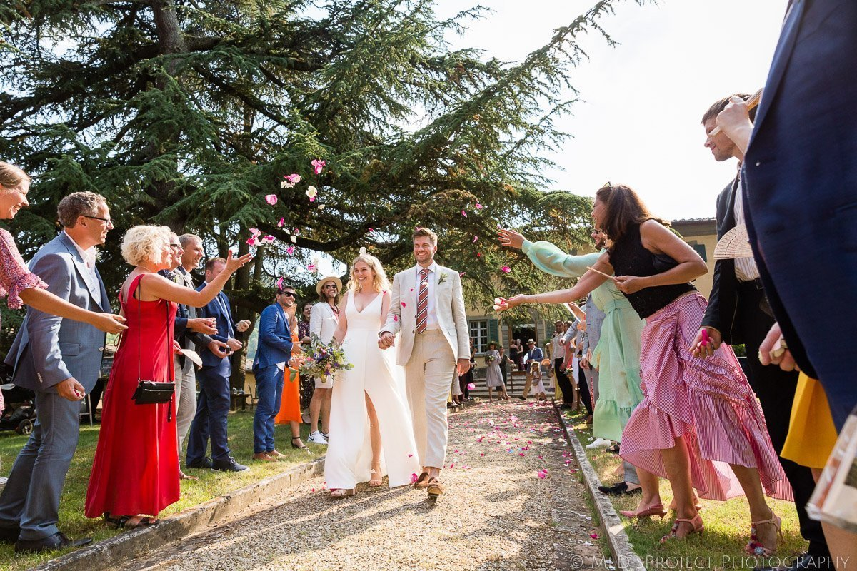 confetti shot after an outdoor wedding ceremony