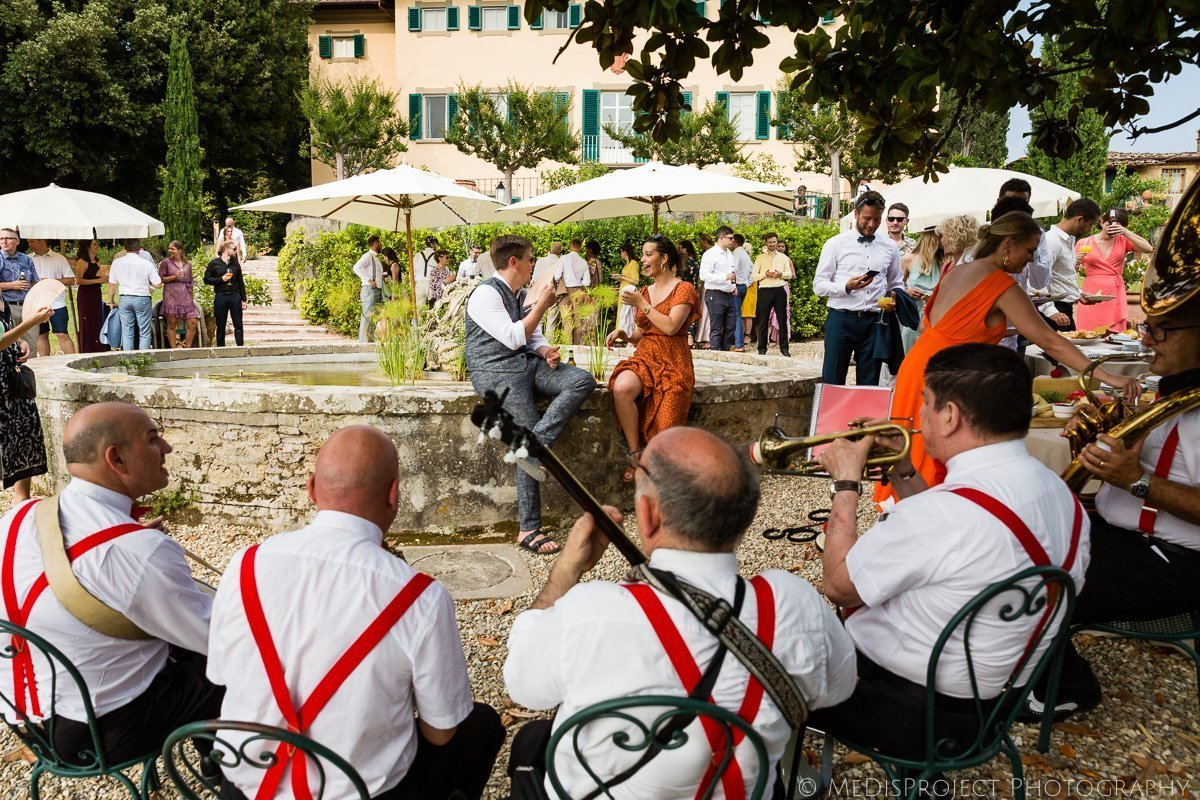 Folk street band playing during a wedding reception