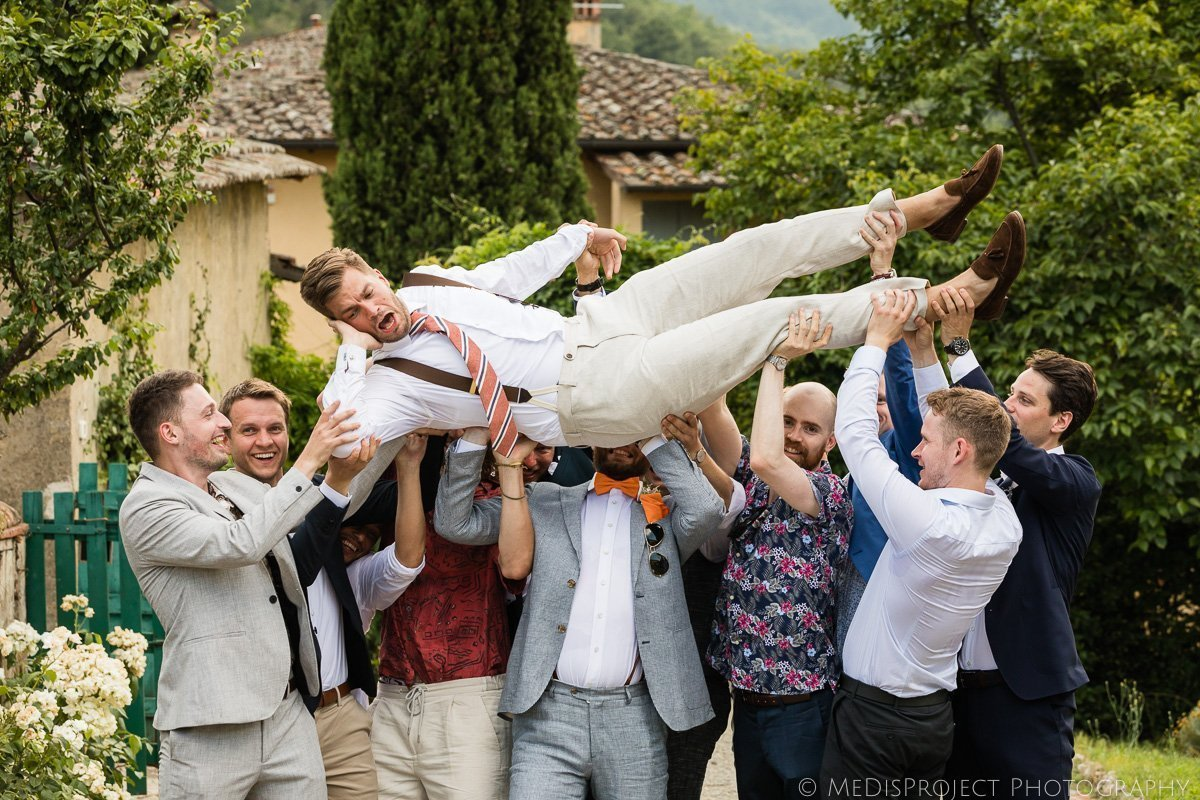 the groom carried in triumph