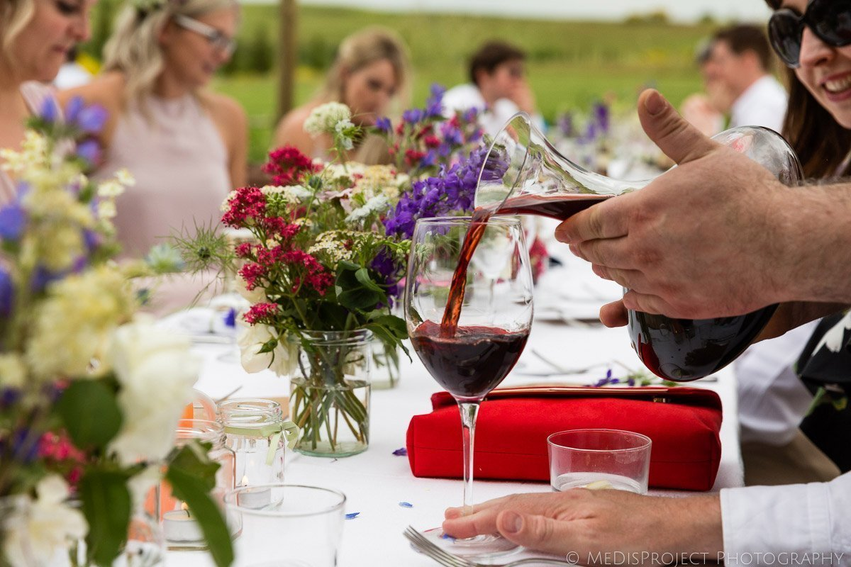 Hands pouring wine for a wedding toast