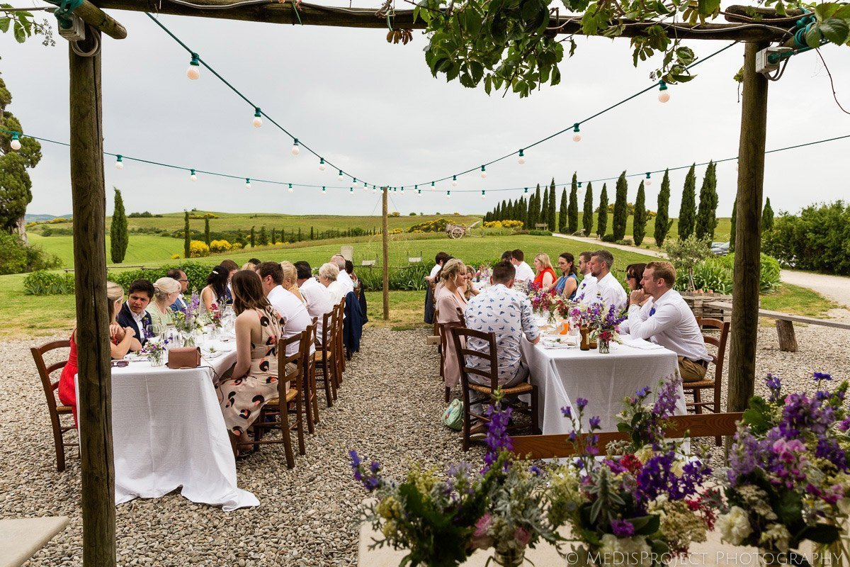 Outdoor wedding dinner tables in Tuscany