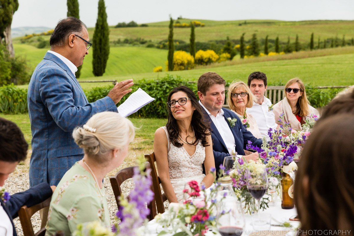 the father of the bride takes his traditional speech before dinner