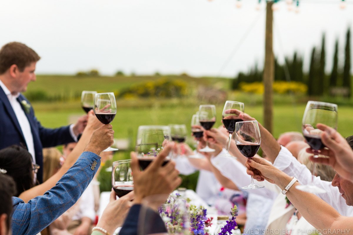 wedding toast with red wine in Tuscany