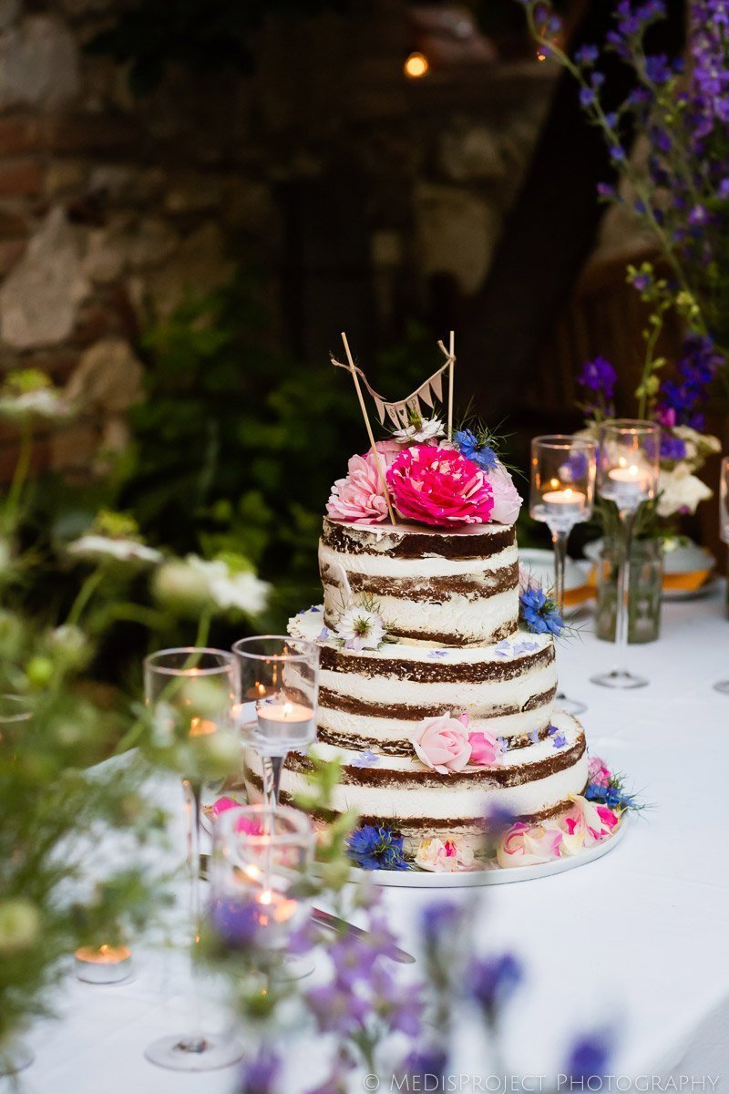 Wedding cake decorated with wild colorful flowers