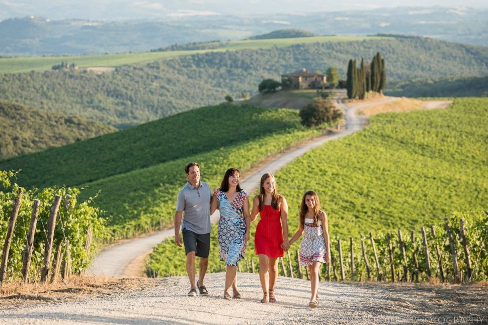 family photo session in the vineyards at Rosewood Castiglion del Bosco