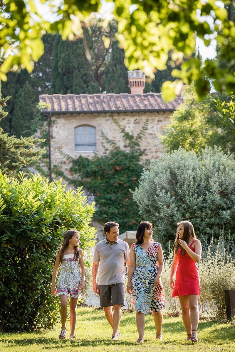 family having a photo session in the garden at Rosewood Castiglion del Bosco