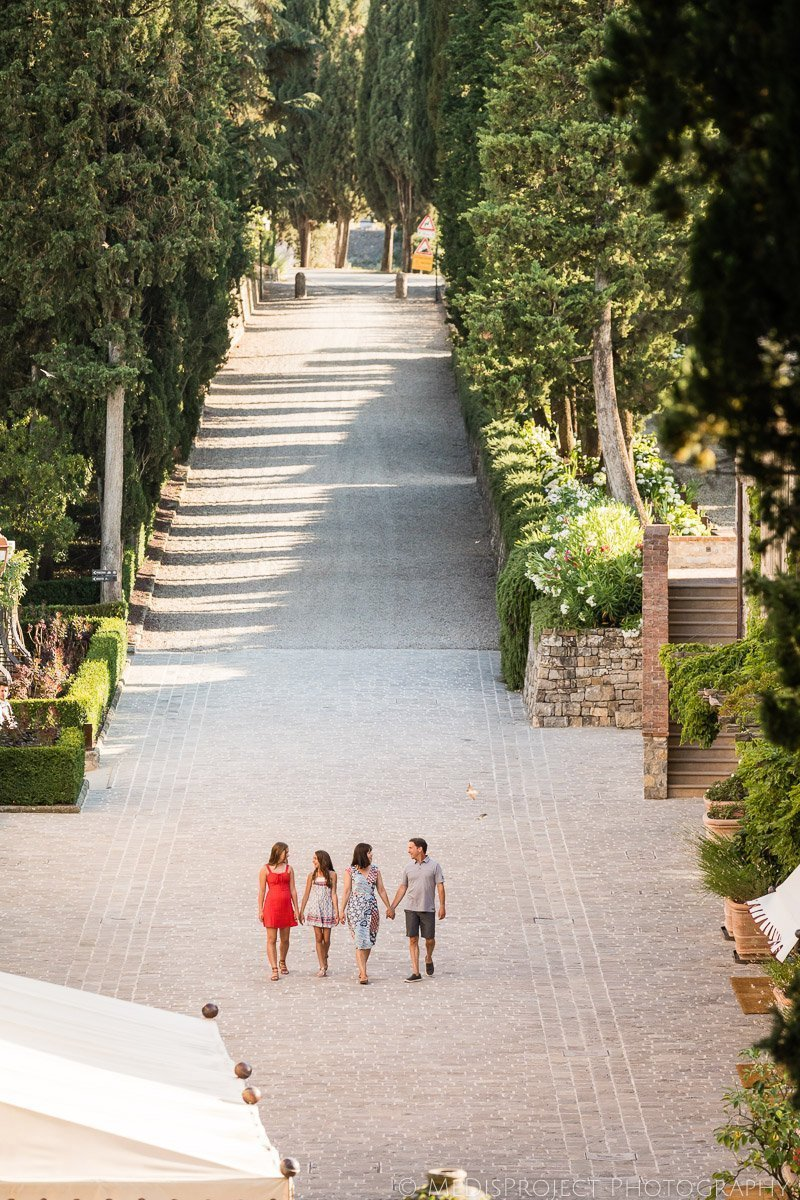family strolling down the boulevard at Rosewood Castiglion del Bosco