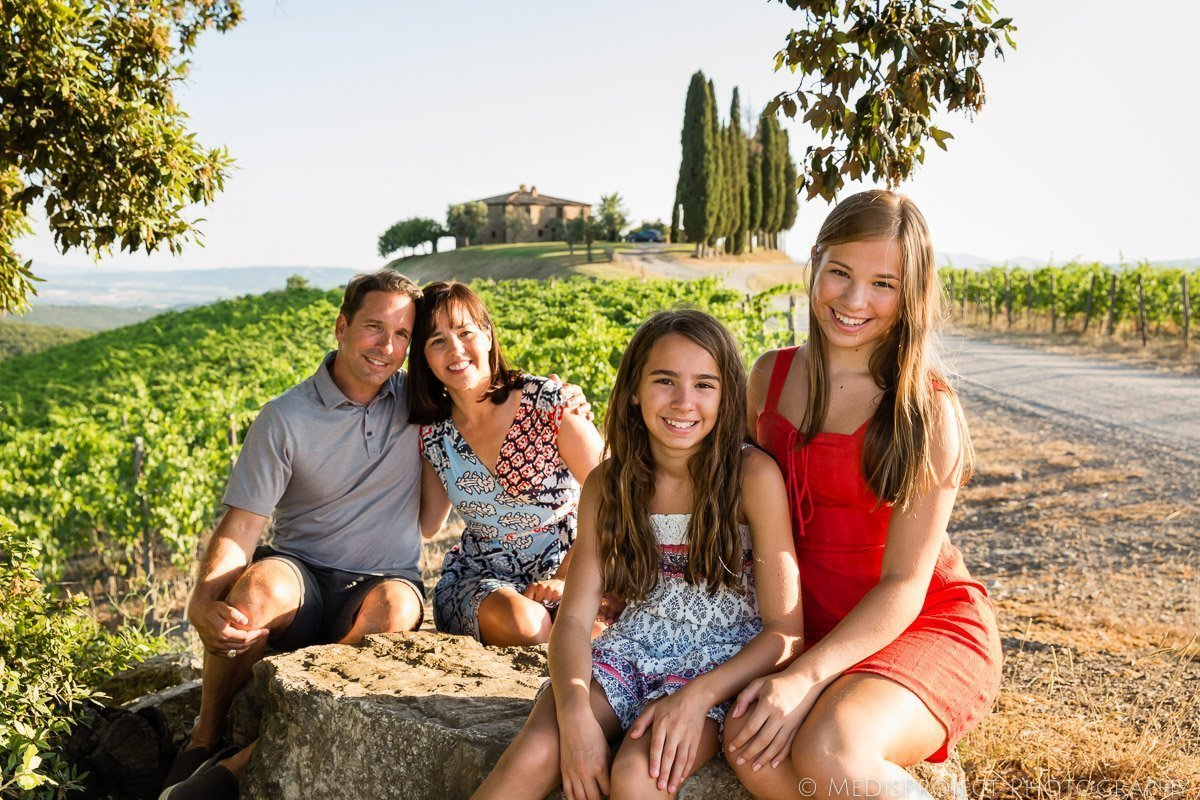 family of four visiting Rosewood Castiglion del Bosco