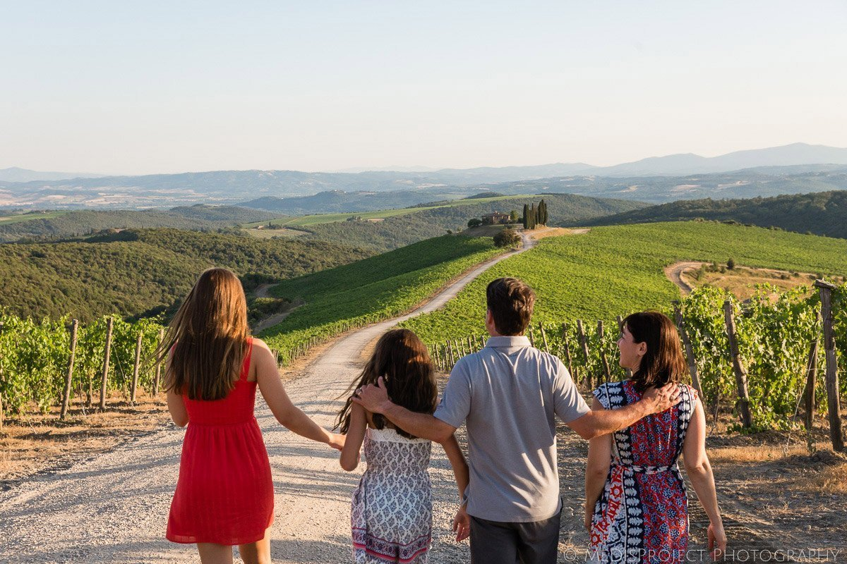 family photo strolling through the Tuscan vineyards