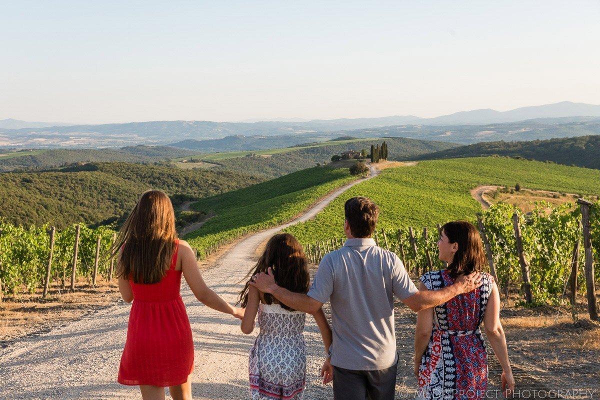 family photo strolling through the Tuscan vineyards