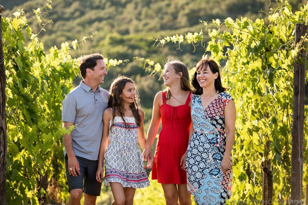 late summer family portrait in the vineyards