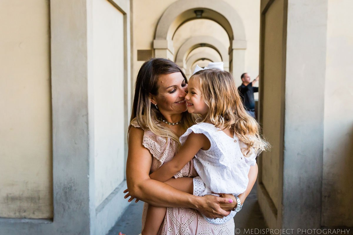 mother and daughter having fun in Florence