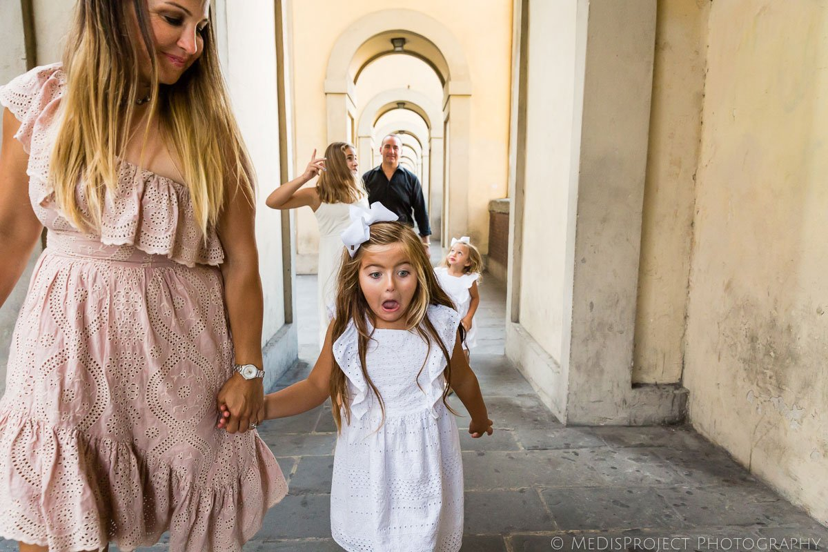 kids having fun while having photo session in Florence