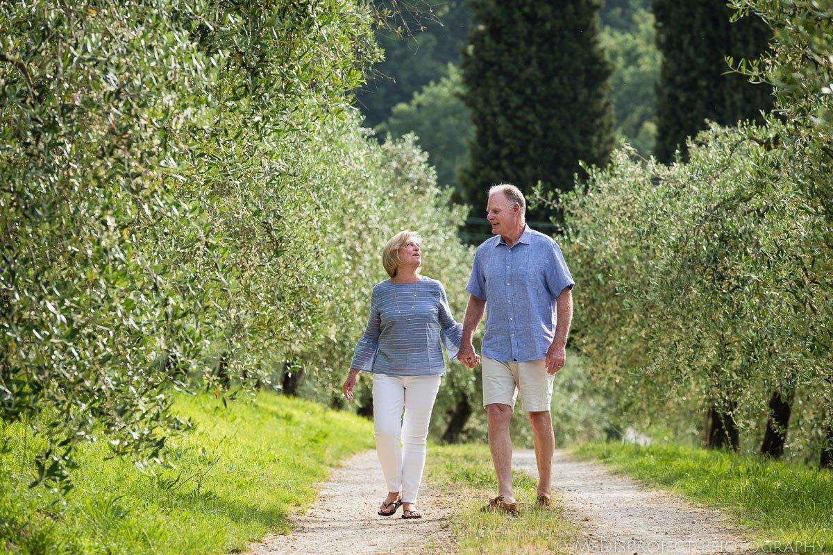 senior couple celebrating their wedding anniversary in Tuscany