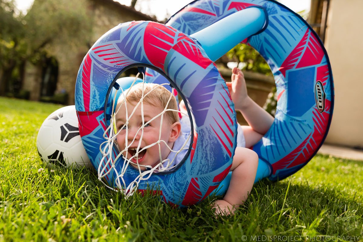 kid having fun with an inflatable basketball hoop