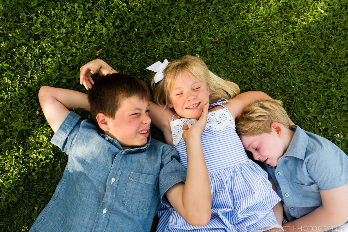 children laying on the grass at Villa Ripanera